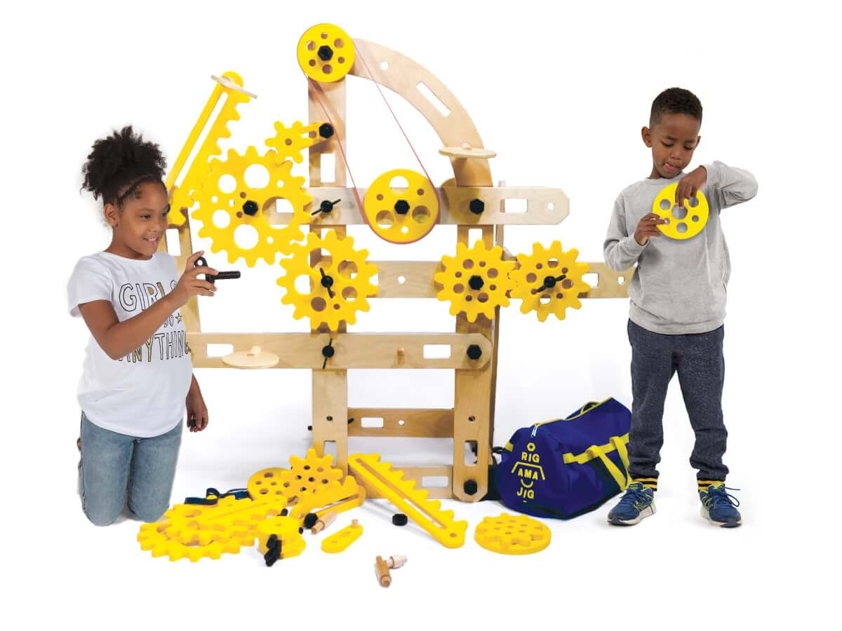 two children play with the Rigamajig Simple Machines Add On kit.