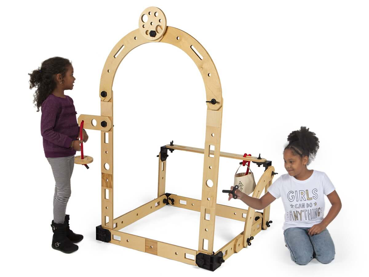 Two children playing with the Rigamajig Basic Builder Kit.